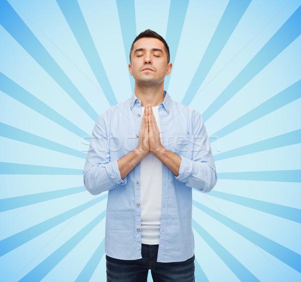 happy man praying Stock photo © dolgachov