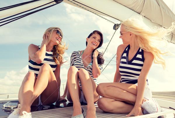 Sonriendo sesión yate cubierta vacaciones Foto stock © dolgachov
