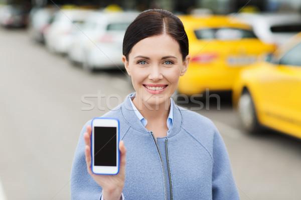 улыбающаяся женщина смартфон такси город путешествия Сток-фото © dolgachov