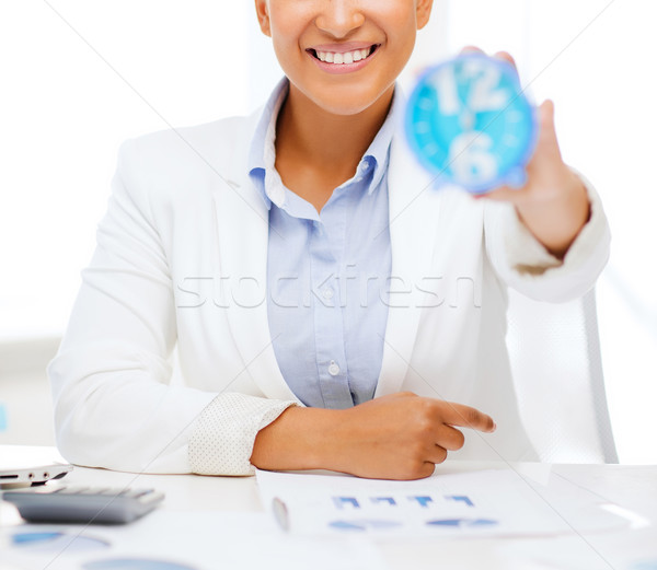 businesswoman working with calculator in office Stock photo © dolgachov