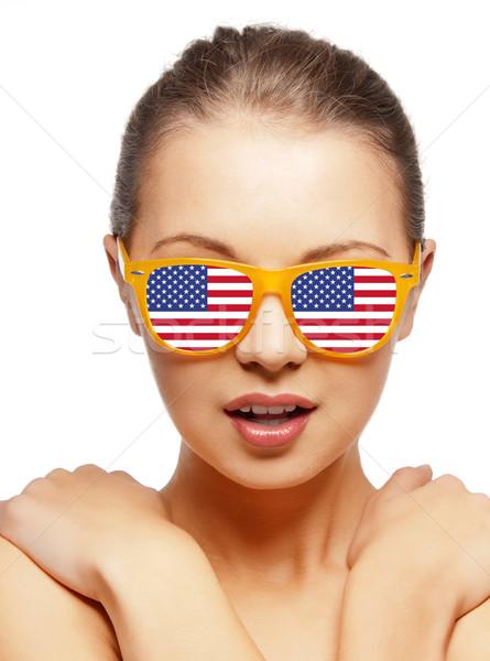 happy teenage girl in shades with american flag Stock photo © dolgachov