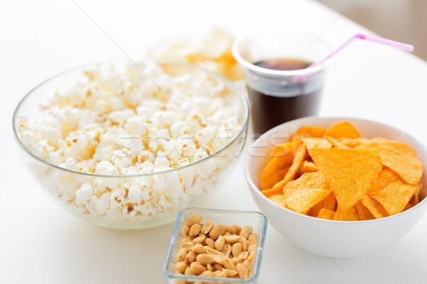 Foto stock: Palomitas · maíz · nachos · de · comida · rápida · una · alimentación · poco · saludable