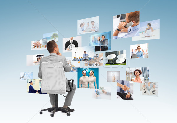 businessman sitting in office chair from back Stock photo © dolgachov