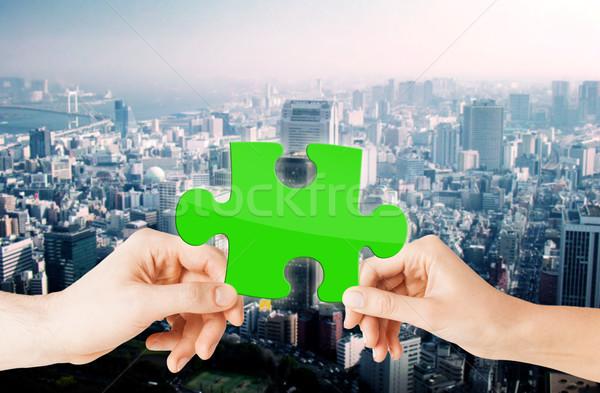 Mãos verde quebra-cabeça cidade natureza ecologia Foto stock © dolgachov