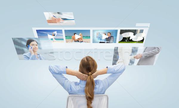 businesswoman watching video media files Stock photo © dolgachov