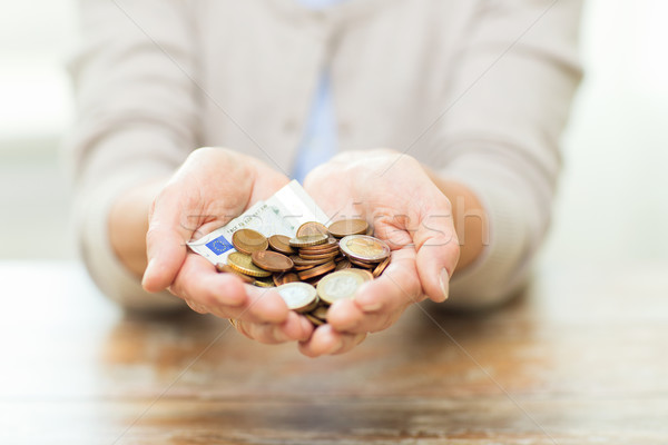 close up of senior woman hands holding money Stock photo © dolgachov