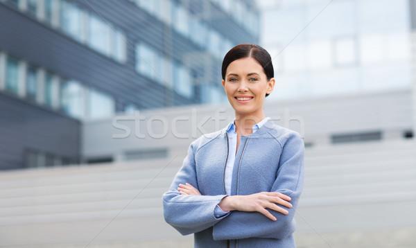 молодые улыбаясь деловая женщина офисное здание деловые люди женщину Сток-фото © dolgachov