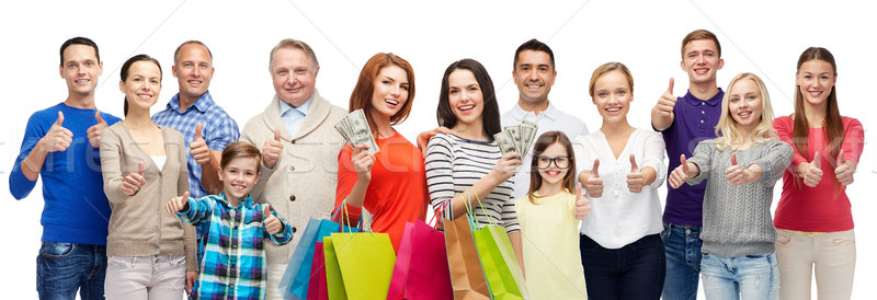 happy people with shopping bags showing thumbs up Stock photo © dolgachov