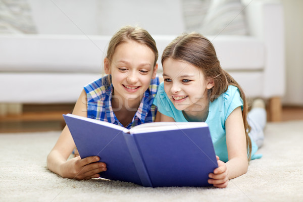 Photo stock: Deux · heureux · filles · lecture · livre · maison