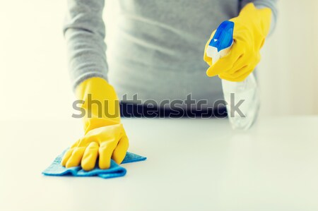 close up of woman wearing protective rubber gloves Stock photo © dolgachov