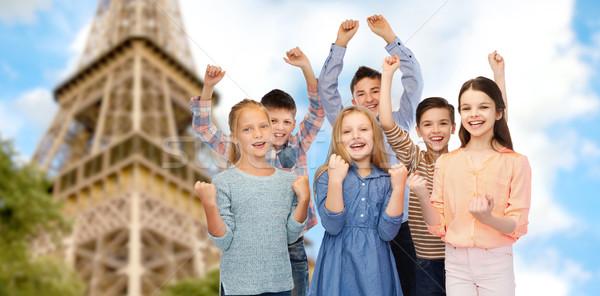 Mutlu çocuklar zafer Eyfel Kulesi çocukluk Stok fotoğraf © dolgachov