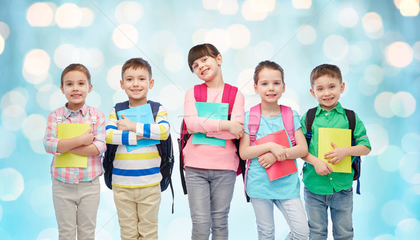 happy children with school bags and notebooks Stock photo © dolgachov