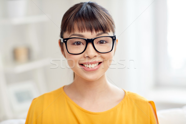 happy asian young woman in glasses at home Stock photo © dolgachov