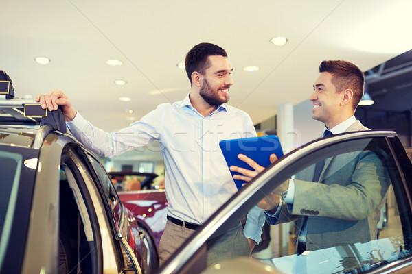 Boldog férfi autókereskedő autó előadás szalon Stock fotó © dolgachov