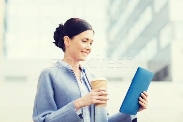 Sonriendo mujer de negocios ciudad negocios tecnología Foto stock © dolgachov