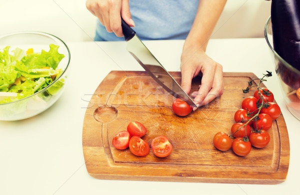close up of woman chopping tomatoes with knife Stock photo © dolgachov
