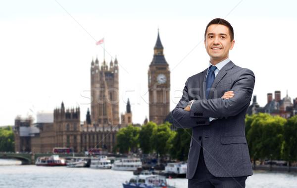 Feliz sorridente empresário terno Londres cidade Foto stock © dolgachov