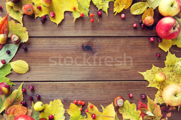 frame of autumn leaves, fruits and berries on wood Stock photo © dolgachov