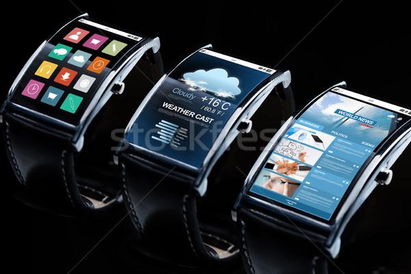 close up of black smart watch set with multimedia Stock photo © dolgachov