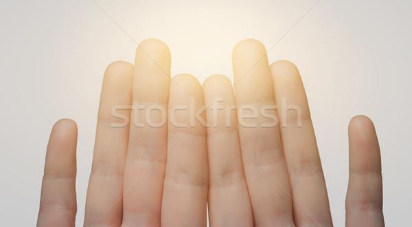 Közelkép kezek mutat nyolc ujjak kézmozdulat Stock fotó © dolgachov