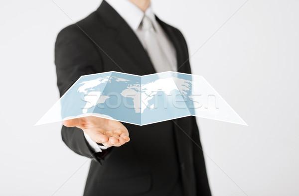 close up of businessman showing world map Stock photo © dolgachov