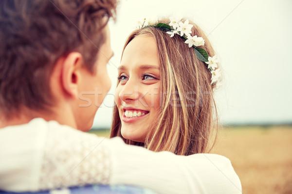 счастливым улыбаясь молодые хиппи пару улице Сток-фото © dolgachov