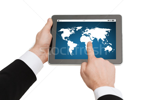 close up of hands holding tablet pc with world map Stock photo © dolgachov