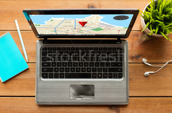 close up of laptop computer with gps navigator map Stock photo © dolgachov