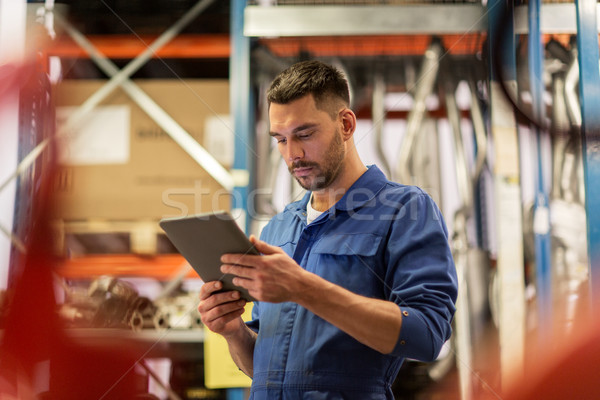 auto mechanic or smith with tablet pc at workshop Stock photo © dolgachov