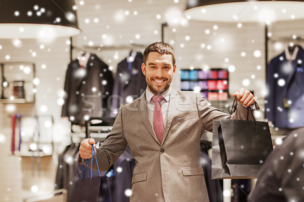 ストックフォト: 幸せ · 男 · ショッピングバッグ · 服 · ストア · 販売