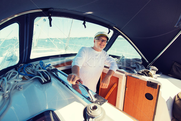 happy senior man on boat or yacht sailing in sea Stock photo © dolgachov