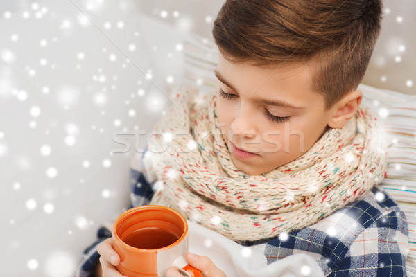 close up of ill boy with flu drinking tea at home Stock photo © dolgachov