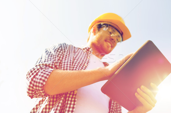 close up of builder in hardhat with tablet pc Stock photo © dolgachov