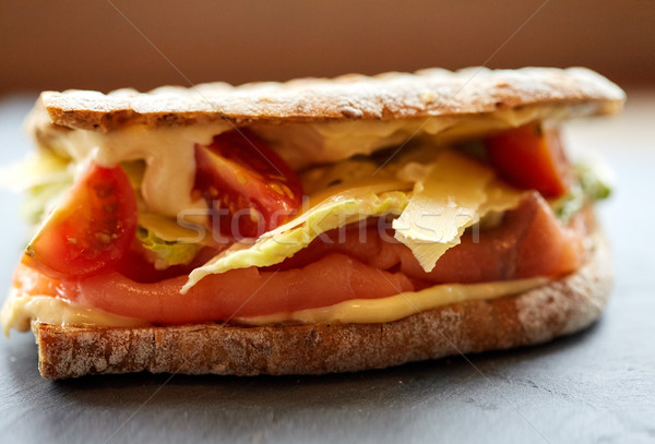 Stock photo: salmon panini sandwich on stone plate