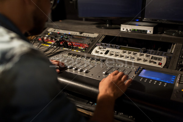 man using mixing console in music recording studio Stock photo © dolgachov