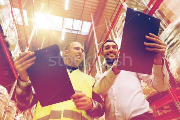 работник бизнесменов буфер обмена склад оптовая торговля люди Сток-фото © dolgachov