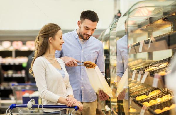 幸せ カップル ショッピングカート 食品 販売 ストックフォト © dolgachov