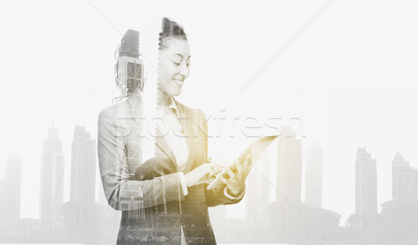 smiling businesswoman with tablet pc computer Stock photo © dolgachov