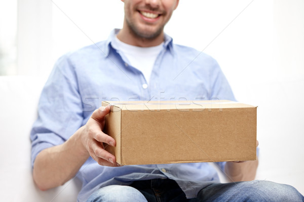 happy man with cardboard box or parcels at home Stock photo © dolgachov