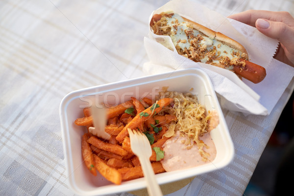 close up of hand with hot dog and sweet potato Stock photo © dolgachov