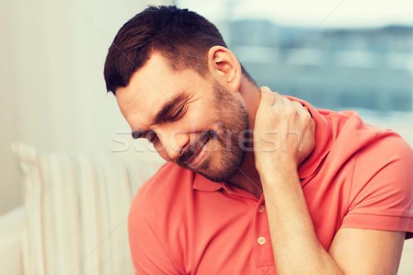 Nieszczęśliwy człowiek cierpienie ból szyi domu ludzi Zdjęcia stock © dolgachov