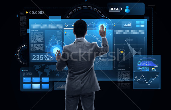 businessman working with virtual reality screens Stock photo © dolgachov