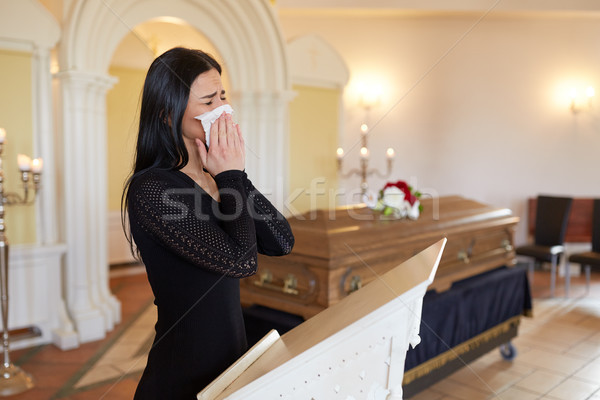 woman crying near coffin at funeral in church Stock photo © dolgachov