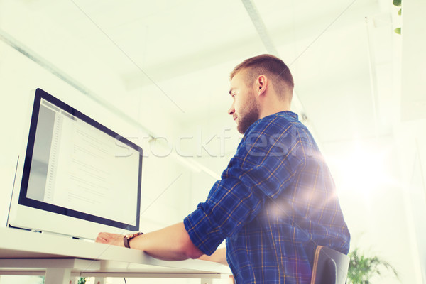creative man or programmer with computer at office Stock photo © dolgachov