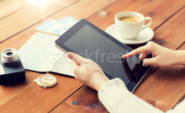 close up of traveler hands with tablet pc and map Stock photo © dolgachov