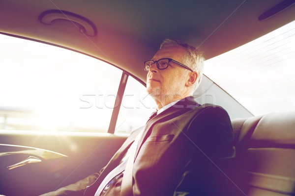 senior businessman driving on car back seat Stock photo © dolgachov