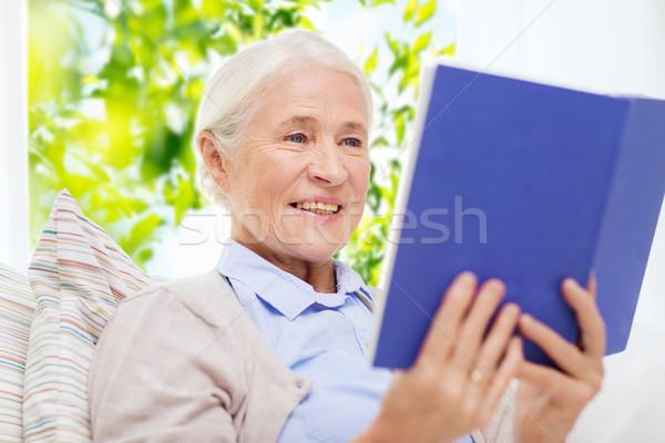 happy smiling senior woman reading book at home Stock photo © dolgachov