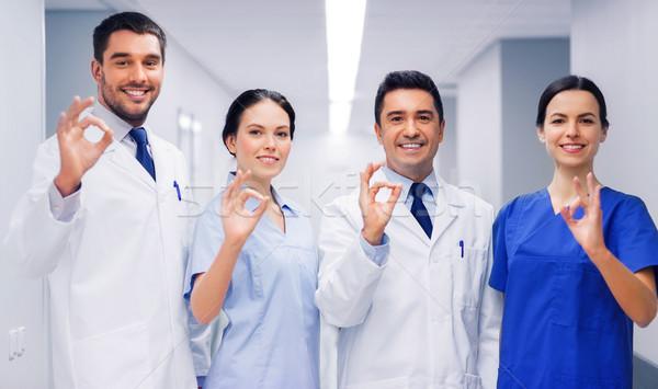 Grupy szpitala znak ręką kliniki Zdjęcia stock © dolgachov