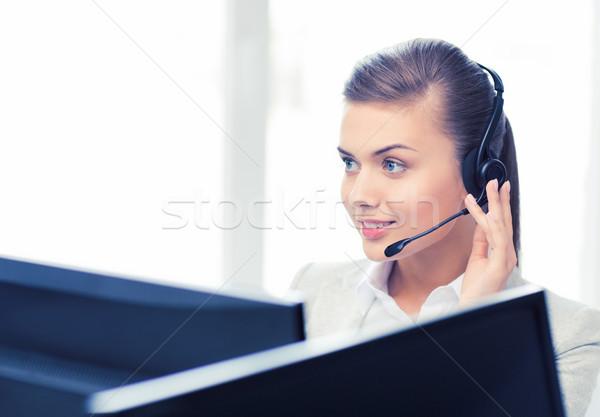 Barátságos női segélyvonal kezelő kép fejhallgató Stock fotó © dolgachov