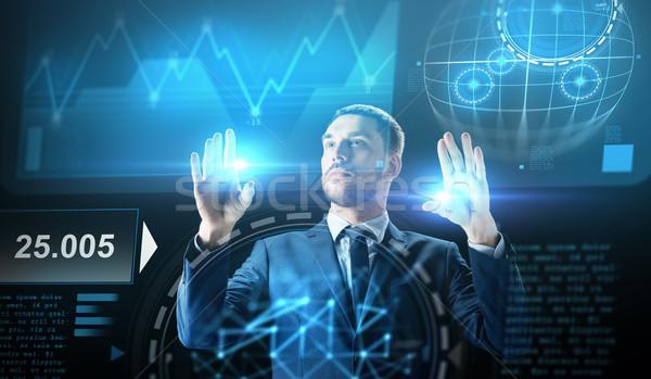 businessman working with charts on virtual screen Stock photo © dolgachov